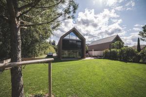 A vendre villa moderne avec vue imprenable sur le lac et le Jura