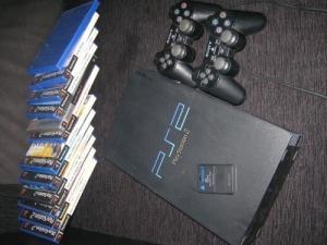 PS 2 + manettes + jeux  à donner