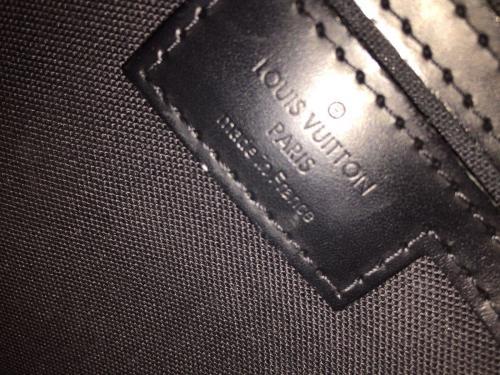 Sac louis Vuitton modele Tadao TBE clé cadenas dustbag