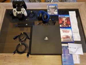 PS4 par 1TB + accessoires + garantie