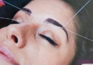 épilation au fil sourcil visage